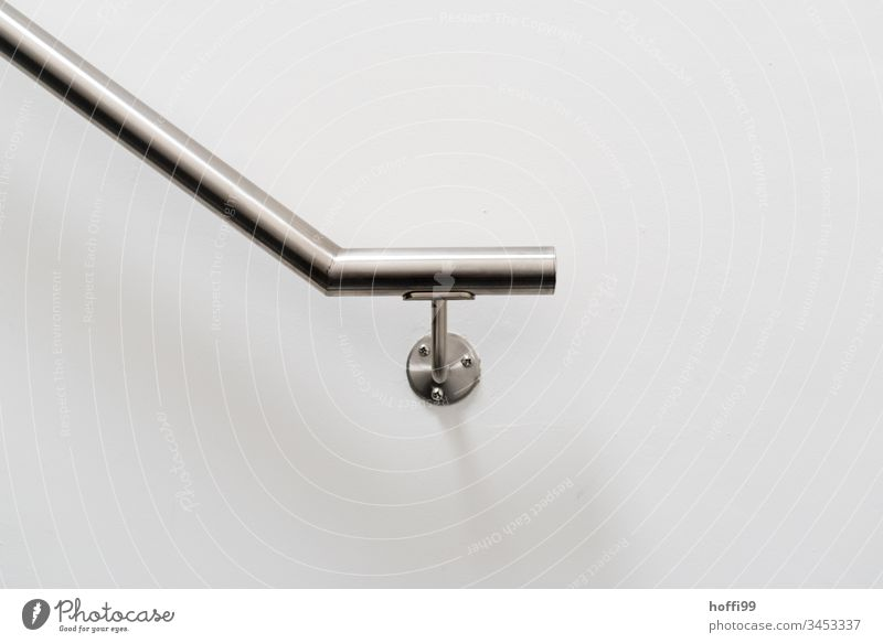 Stainless steel handrail on white wall Railing Handrail Stairs Wall (building) Banister Wall (barrier) Upward Staircase (Hallway) Downward Descent Go up