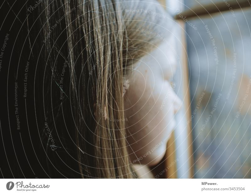 Quarantine Child at home Window Head see hair sad Vantage point on one's own bored Face Infancy Sadness Loneliness people Think Girl Portrait photograph
