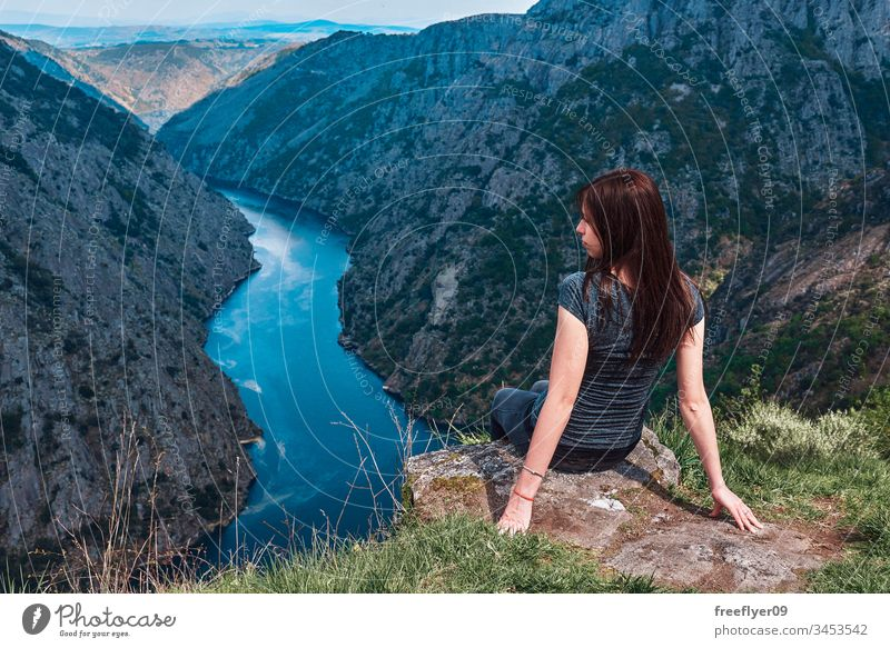 Young woman contemplating the Sil Canyons in Ourense, Spain background beautiful blue canyon cliff environment europa female forest galicia green hat hiking
