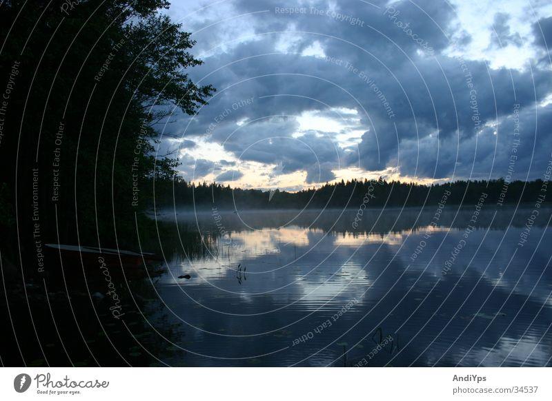 Holmsjo_Evening Lake Watercraft Clouds Sweden Landscape Nature Blekinge Holmsjö