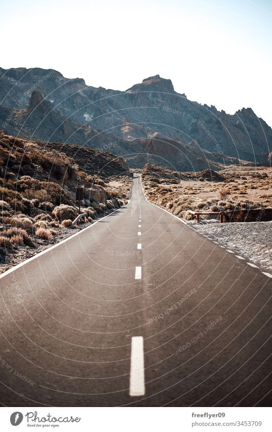 Empty road to the mountains on Tenerife, Spain asphalt clean clear sky cliff cloud cloudscape countryside curve dividing line drive empty freedom hill journey