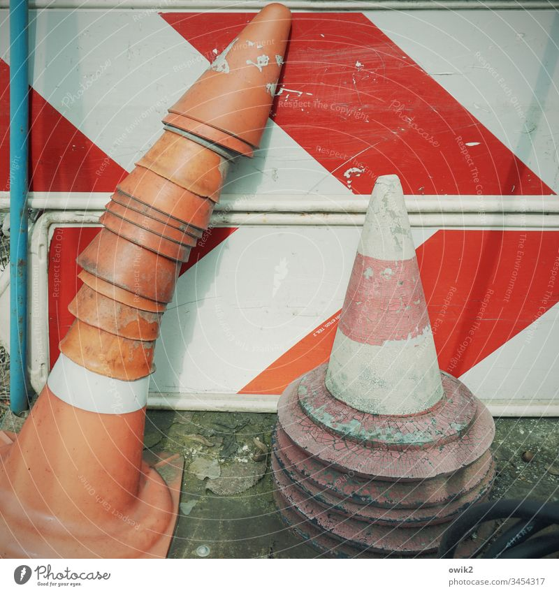 hat game Road traffic sign Road sign Traffic Cone Skittle Hats Red White Reddish white Stack Many Old worn-out Ravages of time depot Colour photo Deserted