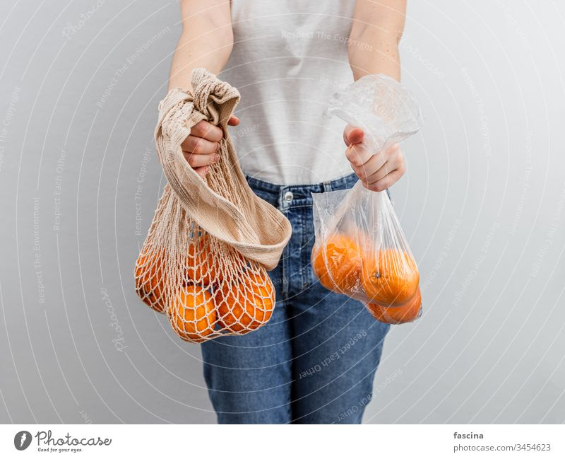 Zero waste, food waste concept. zero waste oranges fruits plastic bag textile mesh top view flat lay plastic-free eco bag reusable bags fabric pouch product