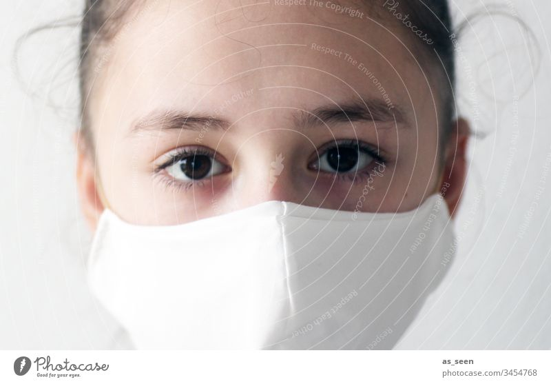 Girl wearing a mouthguard Respiratory protection Respirator mask Mask Human being Colour photo 1 Fear Protection Threat Dangerous Illness coronavirus