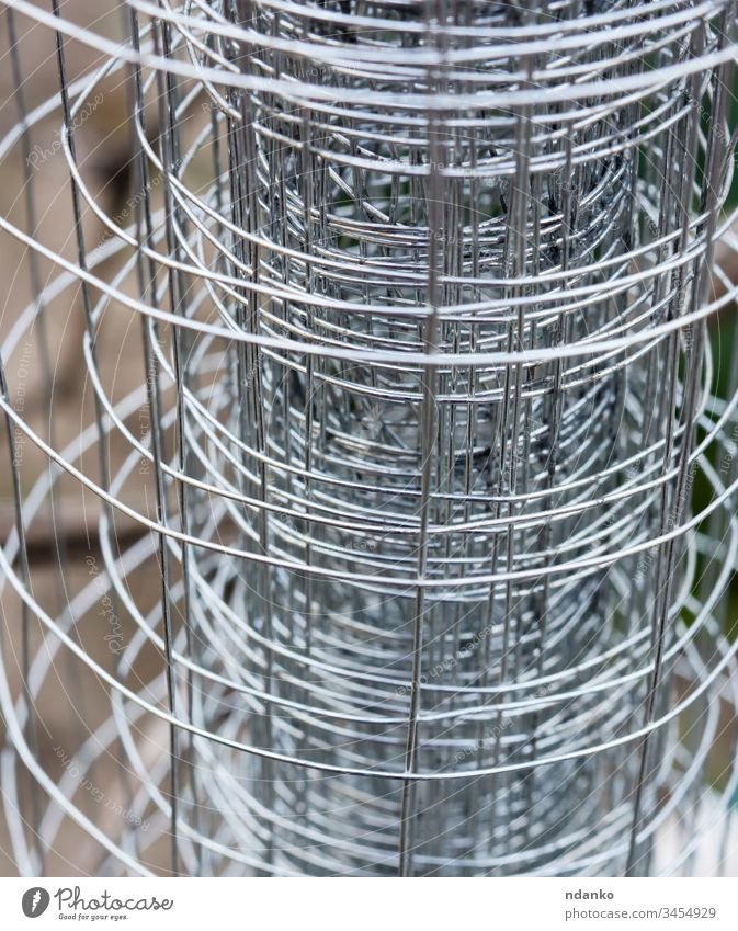 twisted metal fence made of wire abstract barbed barbwire barrier border cage closeup construction defense design element gray grid guard industry iron link