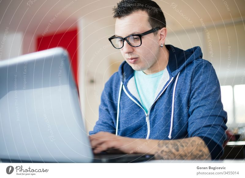 Freelancer working from home adult business caucasian communication computer desk freelancer handsome internet laptop lifestyle looking male man office people