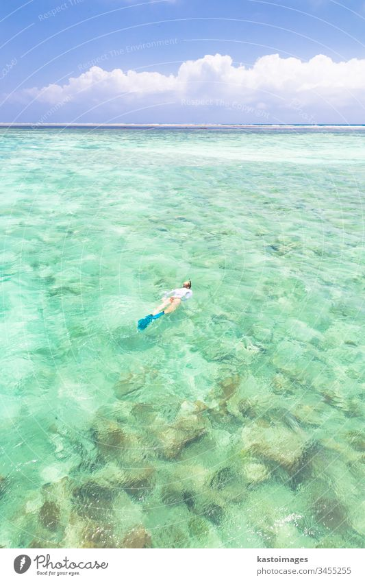 woman snorkeling in turquoise blue sea. Zanzibar Mnemba tropical beach water ocean vacation mask outdoor nature travel island people leisure holiday female