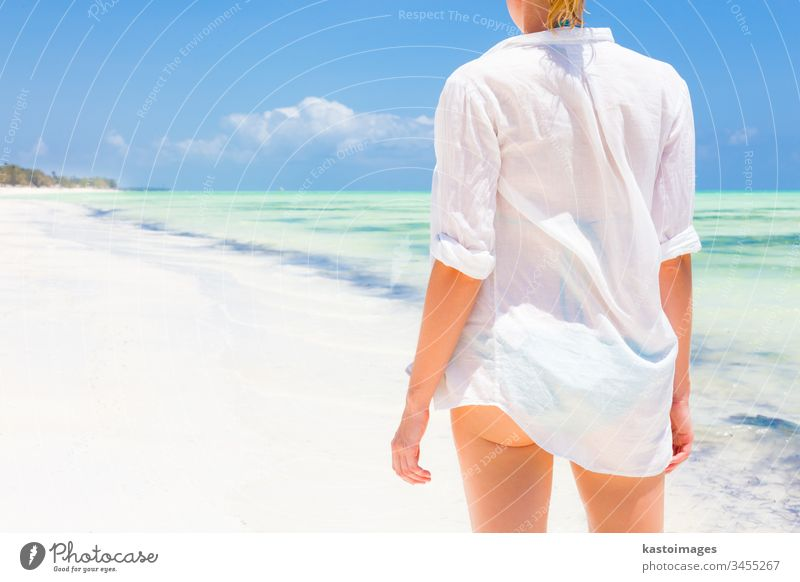 Woman on the beach in white shirt. summer holiday woman travel vacation ocean sea young water beautiful beauty leisure lifestyle girl female relax nature sun