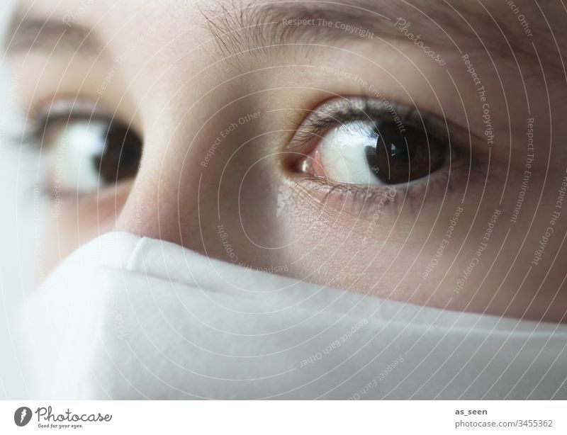 Fearful look of a girl wearing a mask Looking eyes Respirator mask White Protection threat Mask Human being Portrait photograph Threat Colour photo 1 Breathe