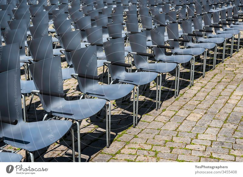 Empty chairs in rows. Open-air theater seats Germany abandoned aged aligned audience auditorium blue business canceled city classic comfort comfortable concert