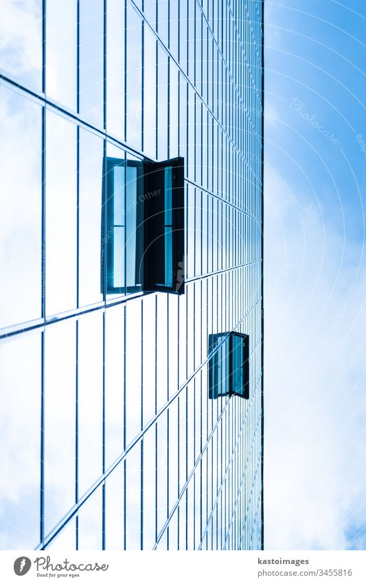 Modern facade of glass and steel. background sky cloud skyscraper abstract economy architecture real estate blue commercial office construction exterior city