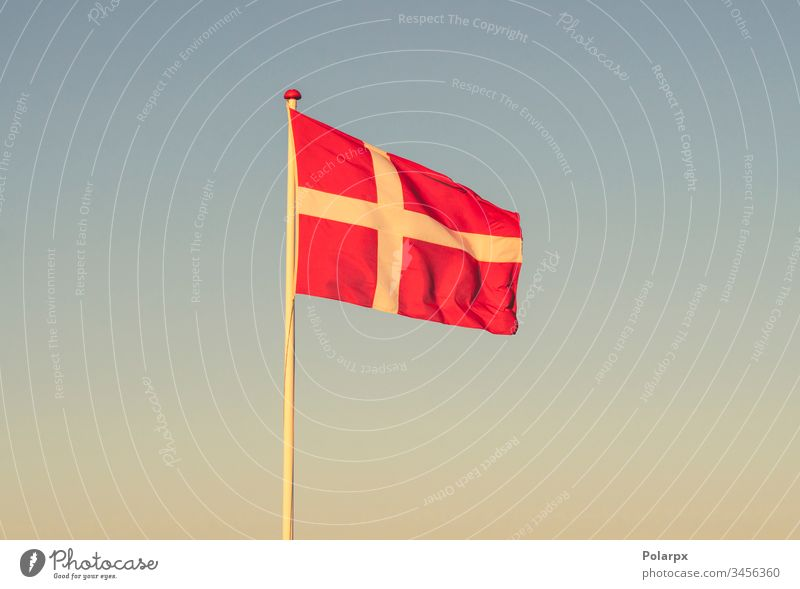Danish flag at dawn waving in the wind danish flag independent friendship material identity destination travel international copenhagen patriot glory white red