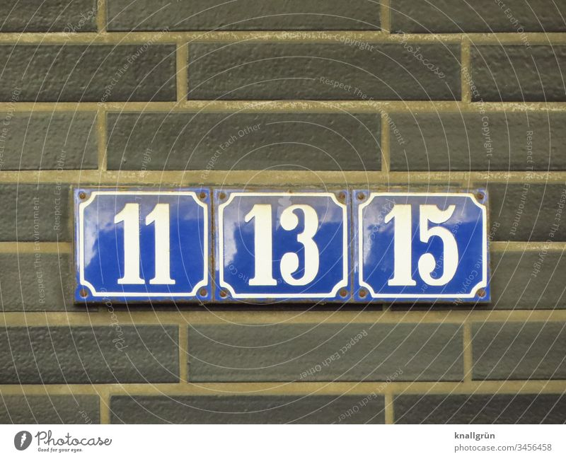 Three blue enamelled house numbers with white numbers 11, 13 and 15 screwed tightly together House number house number plate Digits and numbers Enamel sign