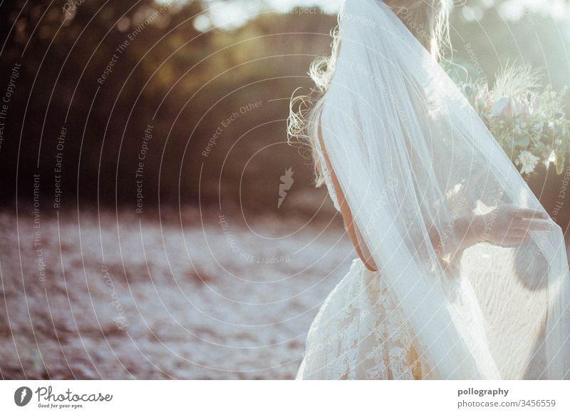Bridal veil in sunshine Bride Wedding dress cover Card Front page Book Exterior shot Dress Copy Space left Contrast Feminine bridal bouquet Wedding ceremony