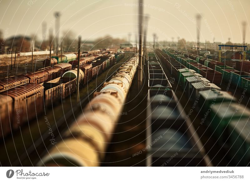 Freight railway cars at the railway station. Top view of cargo trains.Wagons with goods on railroad. Heavy industry. Industrial conceptual scene with trains. selective focus