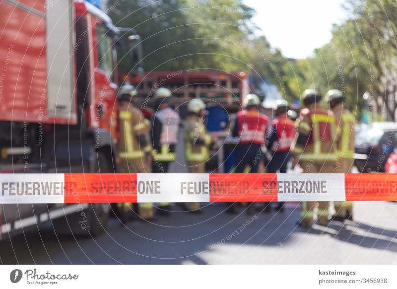Team of firefighters by firetruck on accident location. equipment rescue protection brigade area site team warning helmet emergency uniform protective