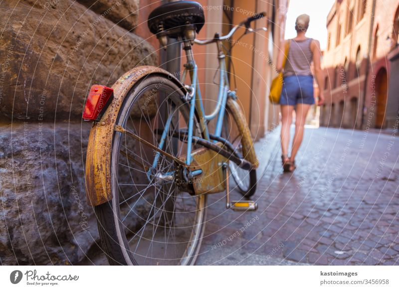 Retro bycicle on old Italian street. bike travel woman lady european town walk building stone architecture vintage sidewalk retro transport behind city bicycle