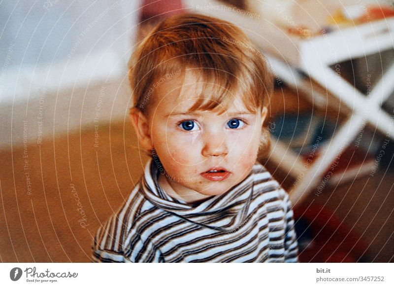 Little girl with a slightly smudged face, at home, looks curiously into the camera. Child Human being Toddler portrait Looking Infancy Forward