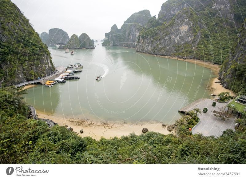 Boats in a book in Ha-Long Bay, Vietnam distance wide Waves Asia Halong Exterior shot Vacation & Travel Halong bay Rock Stone Nature Ocean Landscape