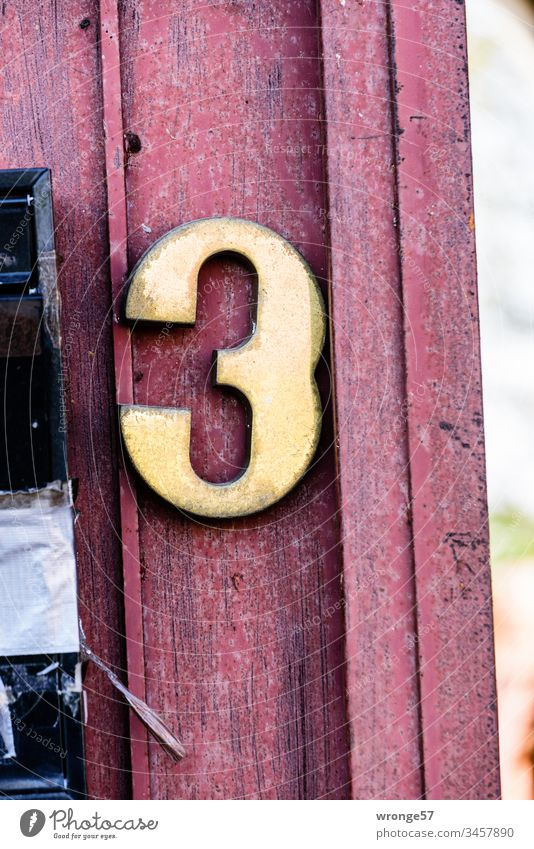 Number 3 on a wooden gate Digits and numbers Close-up Exterior shot House number Orientation Goal front door Colour photo