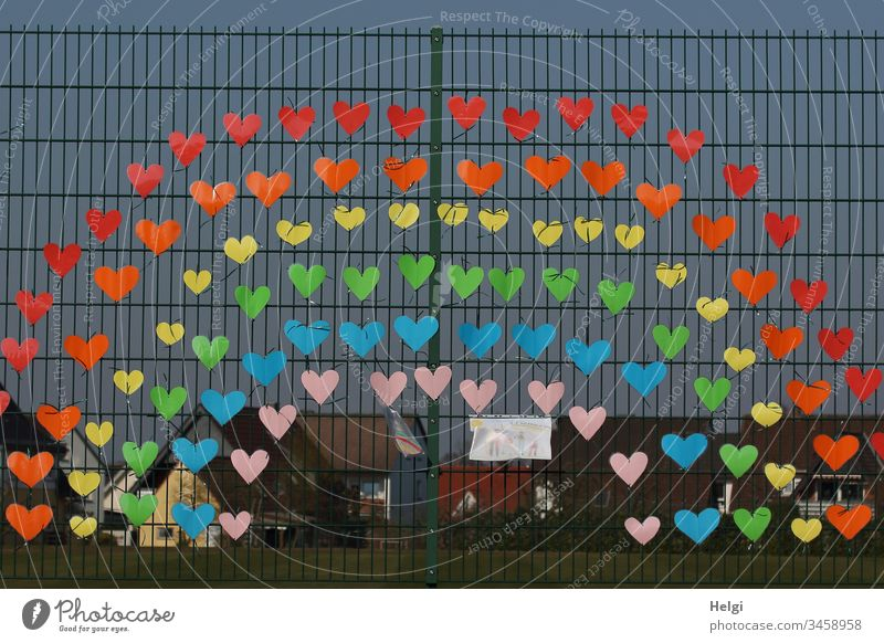Rainbow against Corona at a fence, consisting of many small colorful hearts, as a sign of solidarity cuddle Multicoloured variegated Solidarity Colour photo