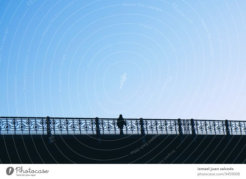 tourist walking on the bridge in Bilbao city Spain, man silhouette person people human pedestrian shadow street outdoors abstract minimal action tourism