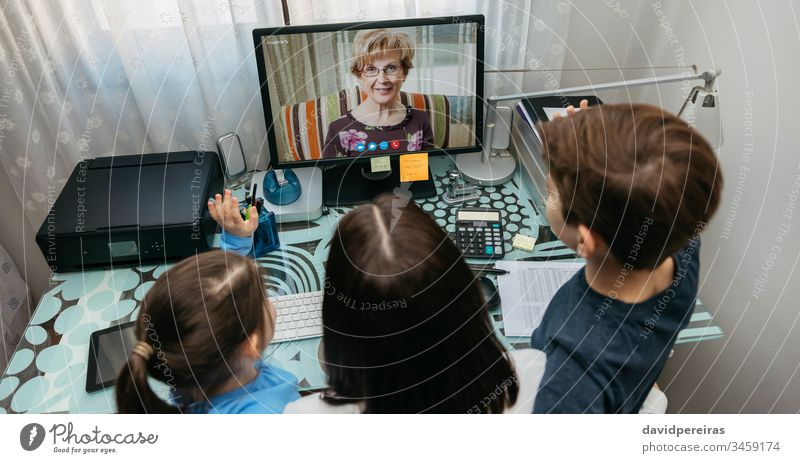 Family talking on video call with grandmother top view family video conference computer coronavirus panorama quarantine covid-19 woman kid child grandma aerial