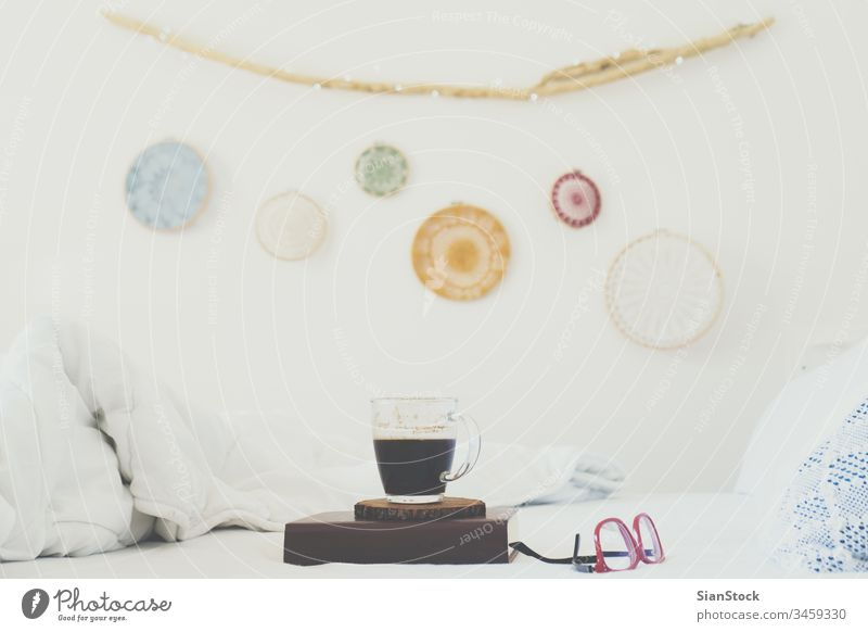 Book, coffee and glasses on the bed wall dreamcatcher sunday book white cup blanket home lights background romantic morning diary drink mug books holiday