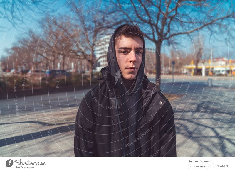 portrait of a serious young man with hoodie lifestyle adolescent adult attractive beautiful beauty boy casual caucasian closeup confidence confident cool