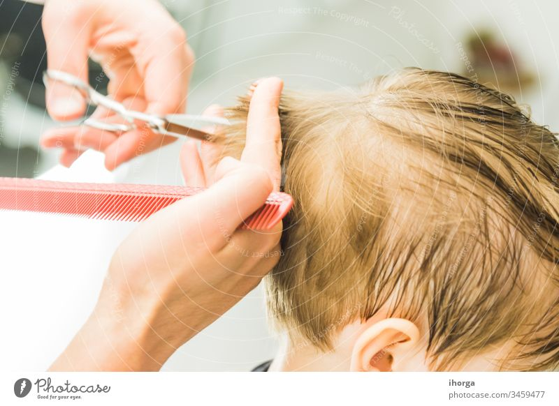the little boy in a hairdressing salon adorable baby barber barbershop beauty blond care caucasian chair child childhood children comb cut cute face fashion