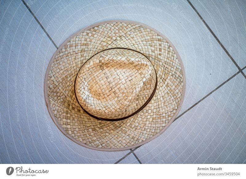 top shot of a straw hat accessory beach brown clothing design fashion floor ground object old one pattern protection retro ribbon shade strawhat style summer