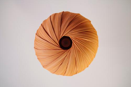 A round lamp made of fabric with folds from below, graphic, orange, cream, circle Round Circle graphically Sun anus buttocks Orange Yellow Light Deserted