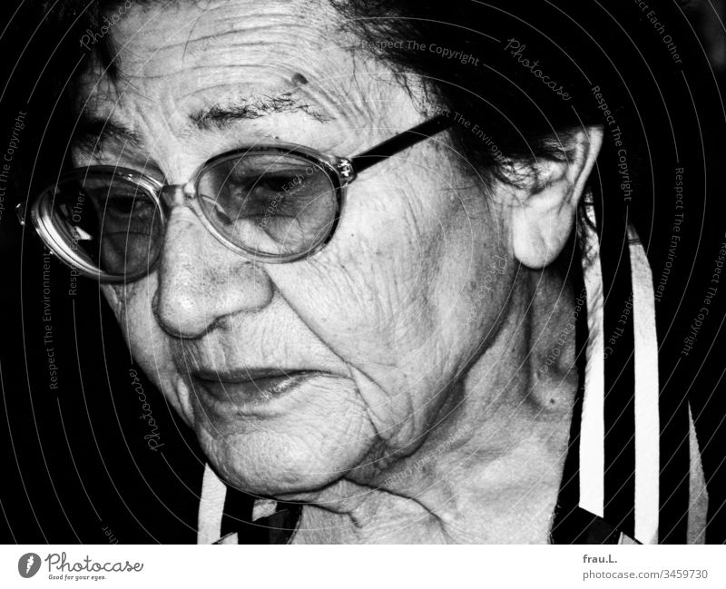 Sadness surrounded the beautiful face of the old woman. Woman Portrait photograph Senior citizen Old Adults Black & white photo Eyeglasses Day sorrow