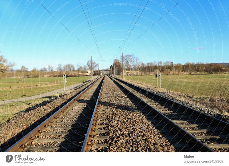 Railway stretching into the distance of fields rail railroad railway travel landscape nature outdoor transportation green track country countryside iron journey