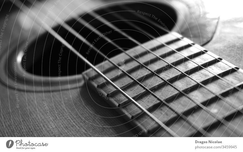 Close up macro on guitar strings black and white photo acoustic art artistic audio band brown classic classical close close up close-up concert entertainment