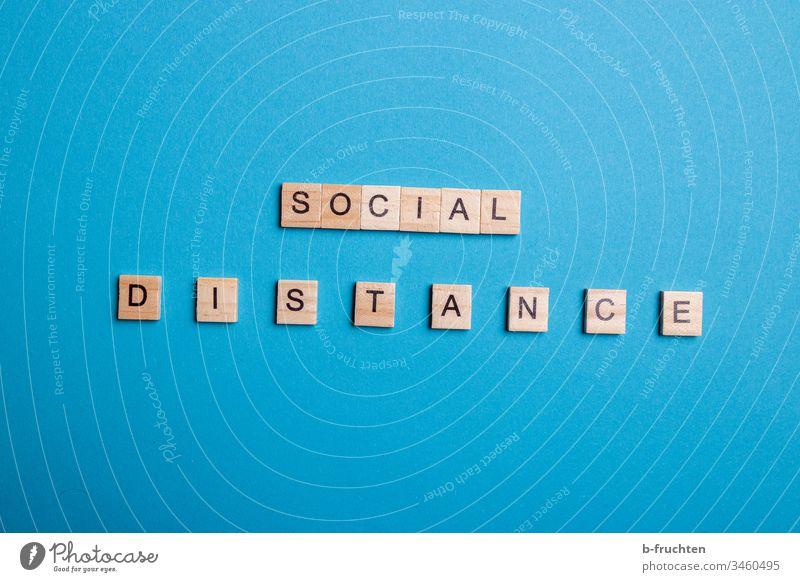 """Scrabble letters """"SOCIAL DISTANCE"""" on blue background Social distance social social distancing Letters (alphabet) Blue Studio shot Neutral Background"""