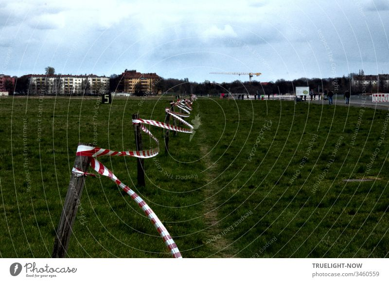 Corona Thoughts | The pandemic makes a lot of things flutter: here is a barrier tape at Berlin's former Tempelhofer Feld airport covid-19 Corona virus