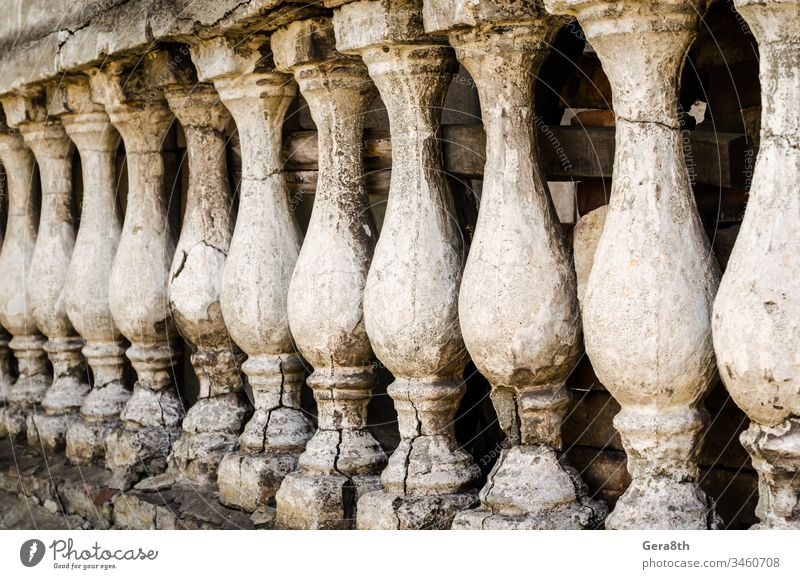 row of antique small columns ancient antique columns architecture cracked cunning decor identical old retro rough row of columns several shabby vintage wall