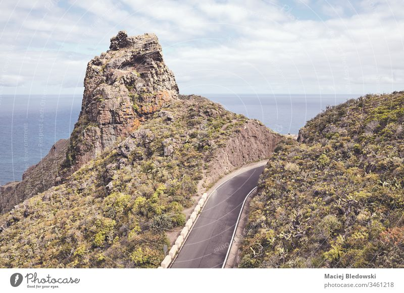 Scenic mountain road. trip journey coast ocean travel Tenerife Spain Canary Island drive way sky filtered Atlantic Ocean asphalt scenery view no people empty