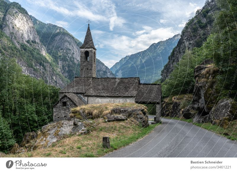 A church in Val Verzasca in Ticino, Switzerland Lavertezzo Exterior shot Canton Tessin Colour photo Landscape Roman arch bridge Morning Verzasca Valley Europe
