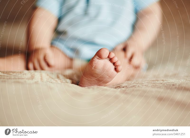 the feet of a small child. Newborn's little fingers. cute little baby feet foot newborn mother beautiful white family closeup love care hand healthy human life