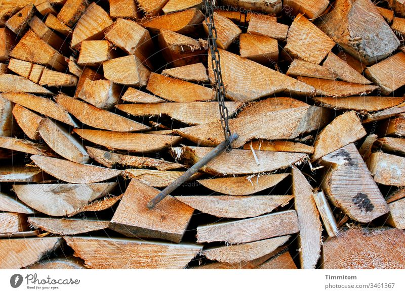 Cut wood and a metal thing Wood boards Firewood Stack of wood Supply Forestry Tree Tree trunk Environment Deserted