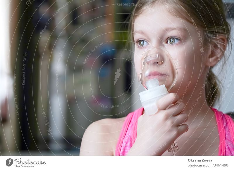 Girl makes inhalation nebulizer at home. Holding a mask nebulizer inhaling fumes spray the medication into your lungs sick patient. Self-treatment of the respiratory tract using inhalation