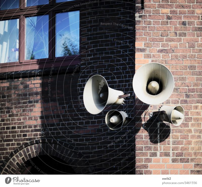 Listen up, everybody. Loudspeaker Signal station Wall (barrier) House (Residential Structure) house corner Wall (building) Facade Brick wall Brick facade