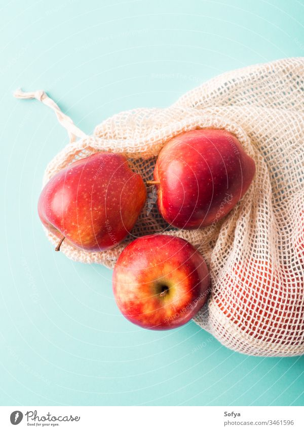 Fresh apples in reusable cotton bag produce grocery zero waste fruit background bright buy color concept cook food fresh green pastel red shop snack vitamin raw