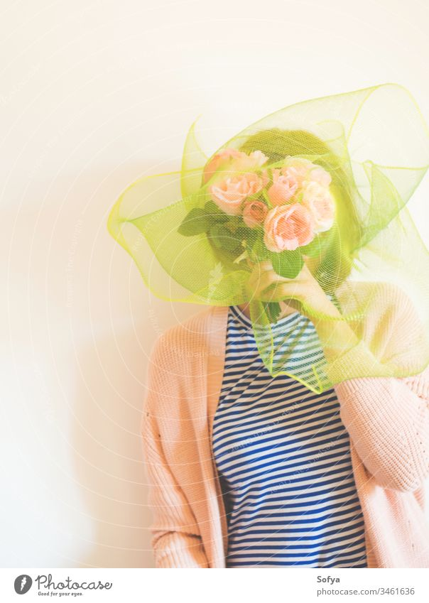 Faceless female portrait with flowers covering her face faceless womens day bouquet mothers day shy woman bunch pink rose holding young beautiful beauty floral