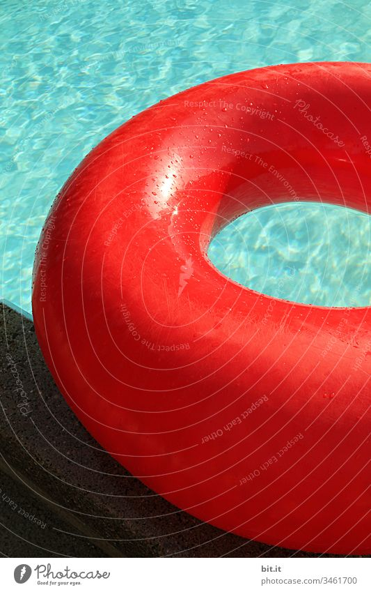 Full to bursting, the large red swimming ring lies on the edge of the pool, in the turquoise water. Swimming & Bathing Swimming pool Water Summer Blue Joy