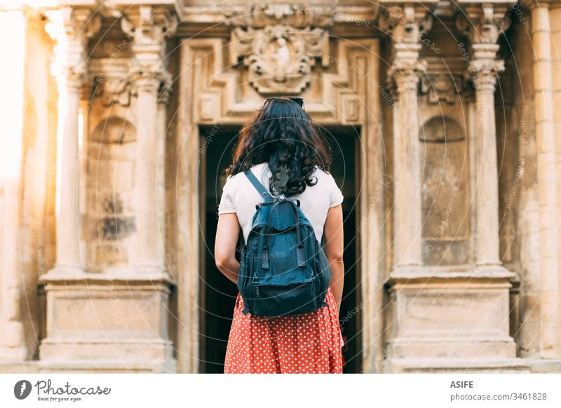 Young tourist woman admirng ancient monuments in Europe travel building church architecture art vacation girl holiday city happy backpack summer spring one