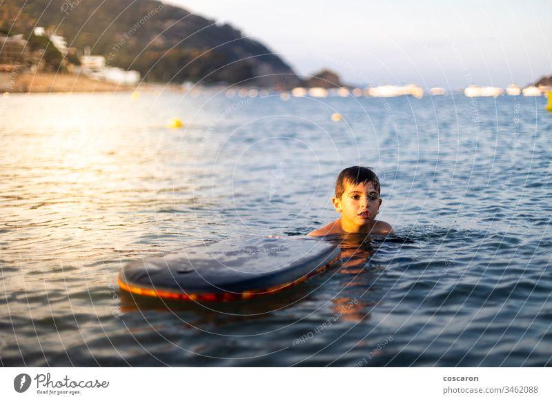 Little child with a bodysurf on the sea active activity beach beautiful beauty blue board boarding bodyboard bodyboarding bodysurfing cheerful childhood coast