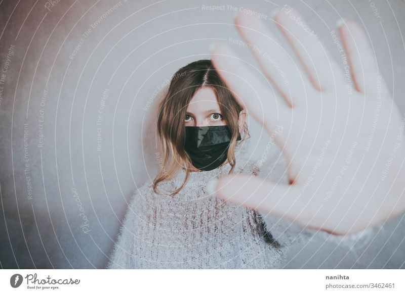 Young woman wearing a mask and put her hand for social distance covid 19 coronavirus breath pandemic illness infected stop contagious infection allergy asthma